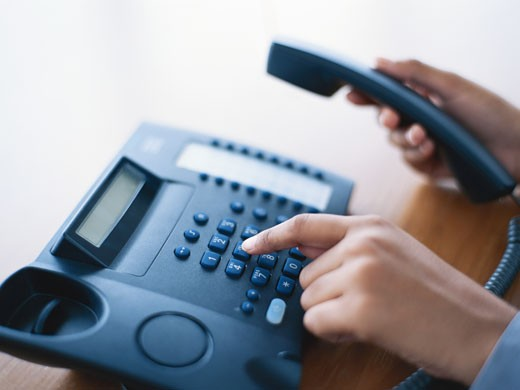Person dialling telephone, close-up : Stock Photo