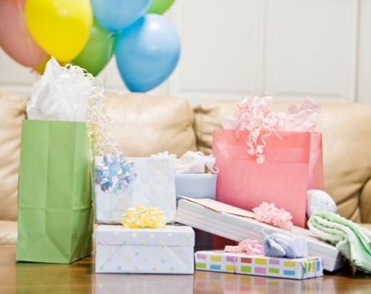Wrapped presents and balloons, indoors : Stock Photo
