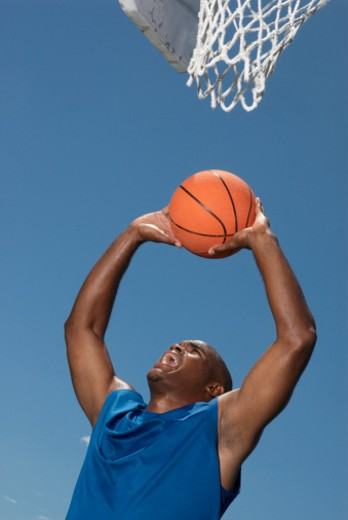 Stock Photo: 1491R-1085074 Basketball player preparing to score