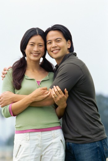 Stock Photo: 1491R-1085760 portrait of a mid adult couple embracing
