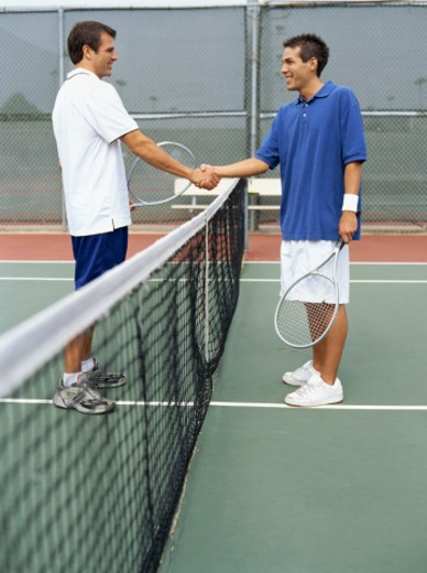 Stock Photo: 1491R-1085899 side profile of a tennis player shaking hands with his opponent