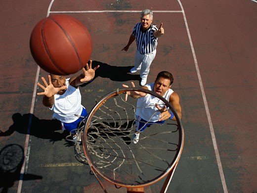 high angle view of two men playing basketball : Stock Photo
