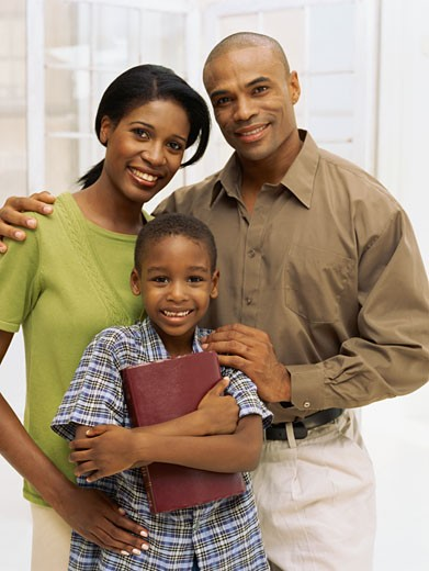 portrait of parents and their son smiling : Stock Photo