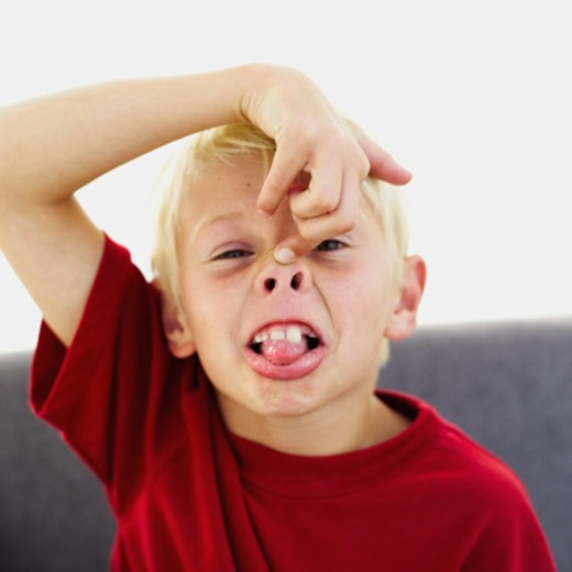 close-up of a boy making a face : Stock Photo