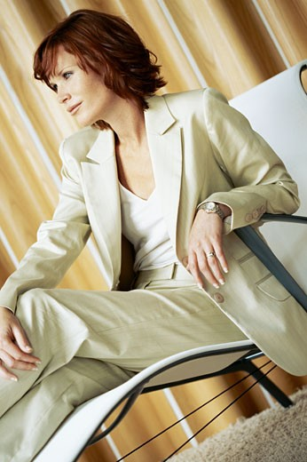 Stock Photo: 1491R-1087691 businesswoman sitting on a chair