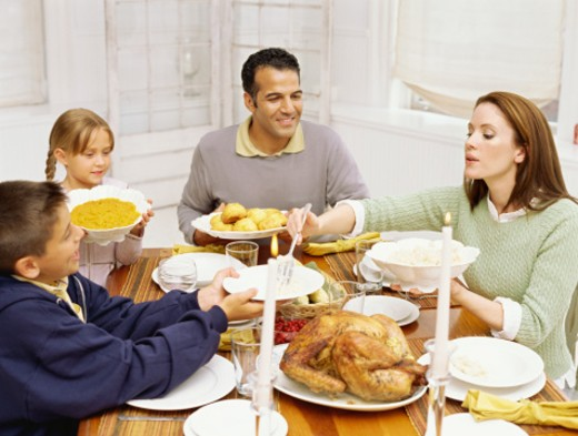 high angle view of a family sitting at a dining table : Stock Photo