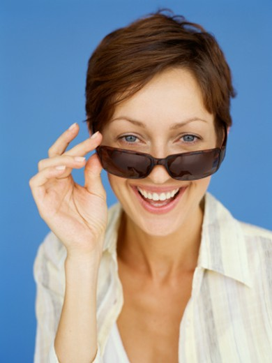 Stock Photo: 1491R-1088474 portrait of a young woman wearing sunglasses