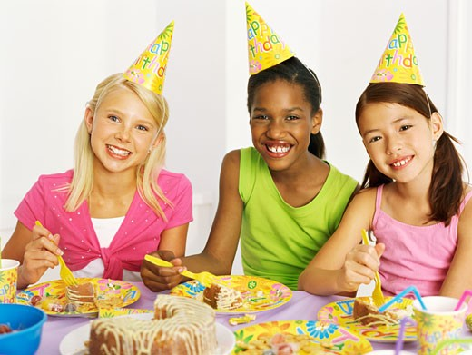 Stock Photo: 1491R-1090620 portrait of three girls eating cake at a birthday party