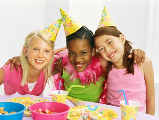Stock Photo: 1491R-1090621 portrait of three girls with their arms around each other at a birthday party