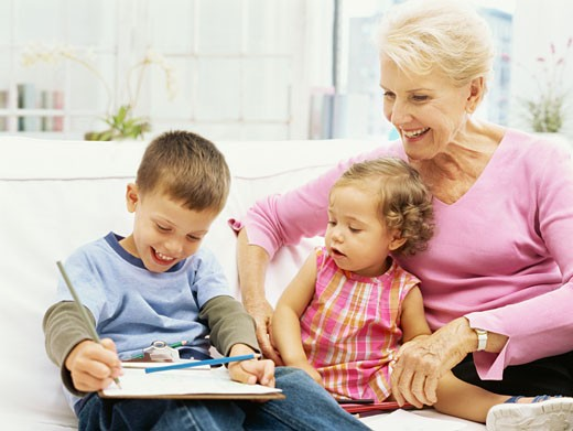 close-up of a grandmother with her grandchildren : Stock Photo