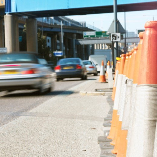 Stock Photo: 1491R-1091522 traffic cones on the road