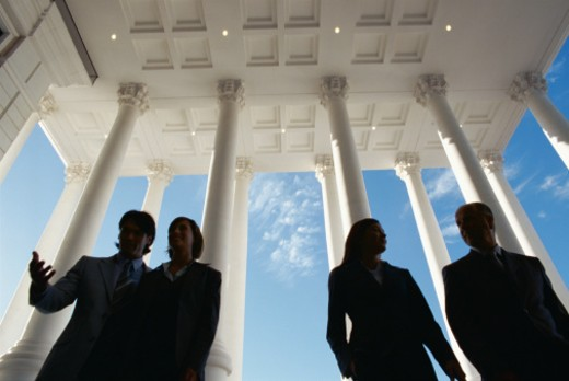 low angle view of two businessmen and two businesswomen : Stock Photo