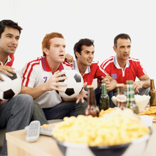 Stock Photo: 1491R-1091991 four young men wearing soccer jerseys