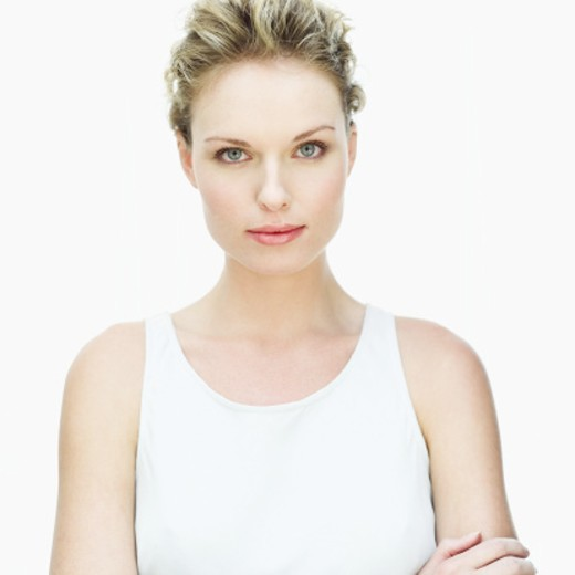 portrait of a young woman with her arms folded : Stock Photo