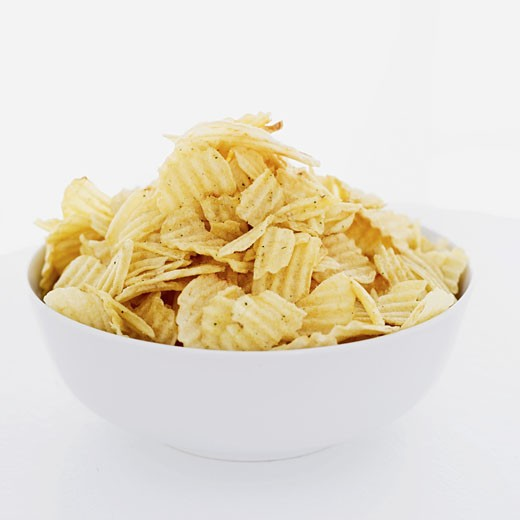 close-up of a bowl of ridged crisps : Stock Photo