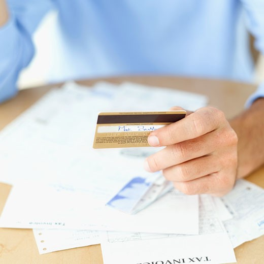 Stock Photo: 1491R-1094148 close-up of a person's hand holding a credit card