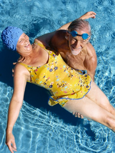 Senior couple in swimming pool : Stock Photo