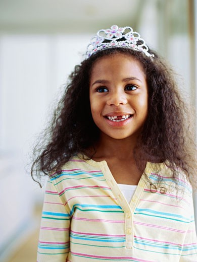 Portrait of a girl wearing a crown : Stock Photo
