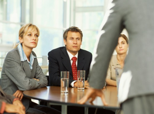 Four businesspeople discussing at a boardroom table : Stock Photo