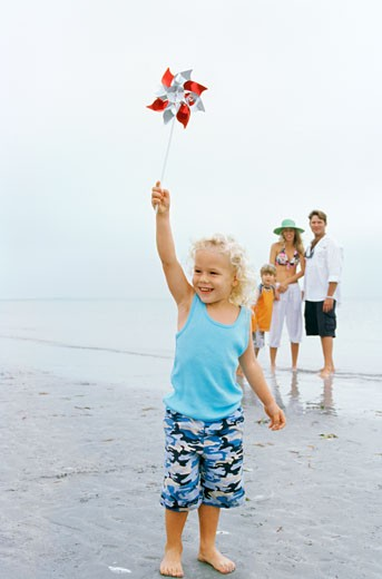 Stock Photo: 1491R-1097886 Girl standing on the beach