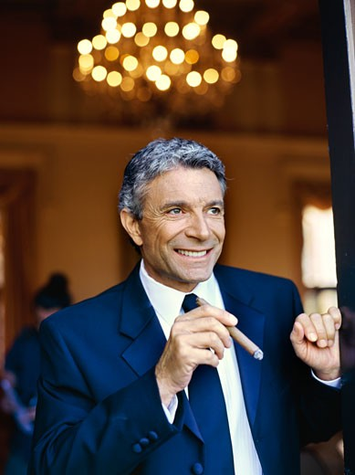 Close up of a mature man holding a cigar : Stock Photo