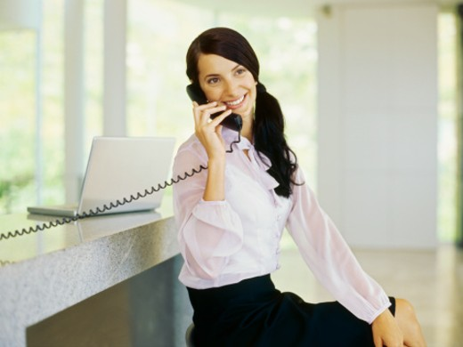 Close-up of a businesswoman using a phone : Stock Photo