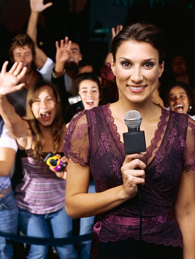 Close-up of a tv presenter near enthusiastic fans at ceremony award : Stock Photo