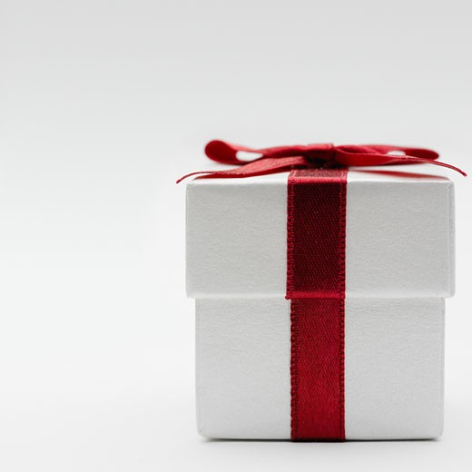 Close-up of gift box with red bow : Stock Photo