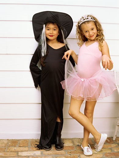 Young girls costumed as a witch and a princess : Stock Photo