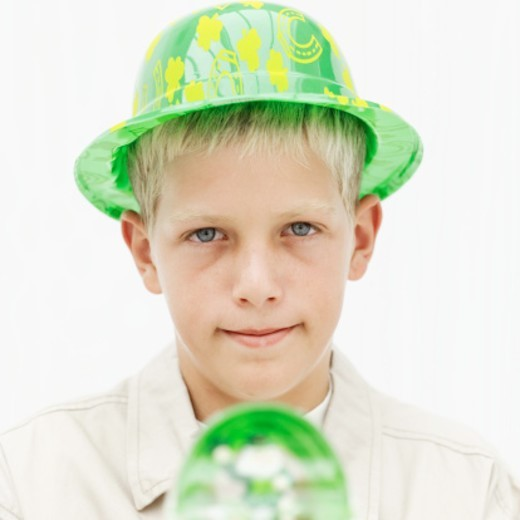 Stock Photo: 1491R-1103846 Close up of a boy (11-13) wearing a leprechaun hat