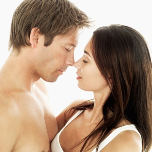 Stock Photo: 1491R-1108441 Side profile of a young couple embracing