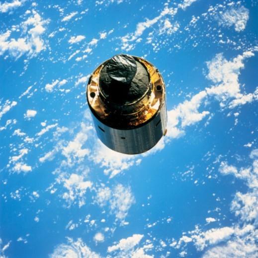 satellite in orbit around the earth : Stock Photo