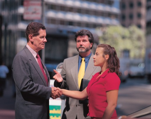 Stock Photo: 1491R-1111631 businessman introducing a man and woman