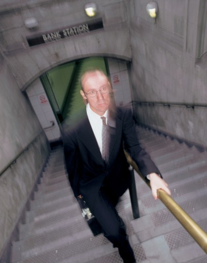blurred shot of a business climbing stairs : Stock Photo