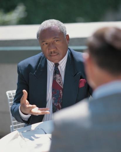 Stock Photo: 1491R-1111962 two businessmen talking
