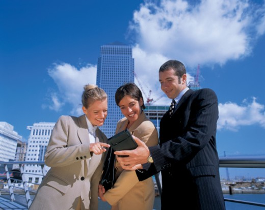 business executives standing and talking outdoors : Stock Photo