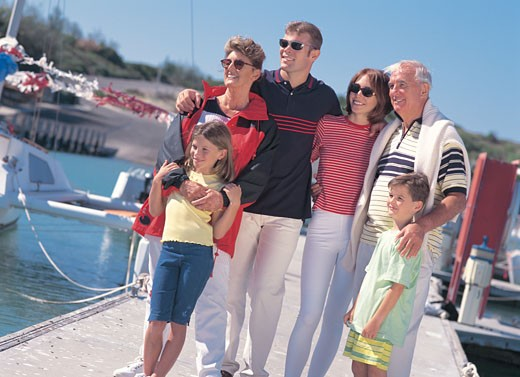 a family standing on a pier : Stock Photo