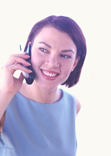 portrait of a young woman talking on the phone : Stock Photo