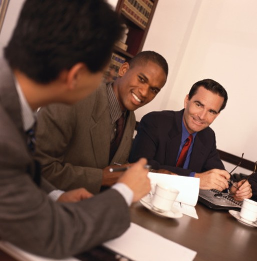 Stock Photo: 1491R-1113492 side profile of business associates at a meeting
