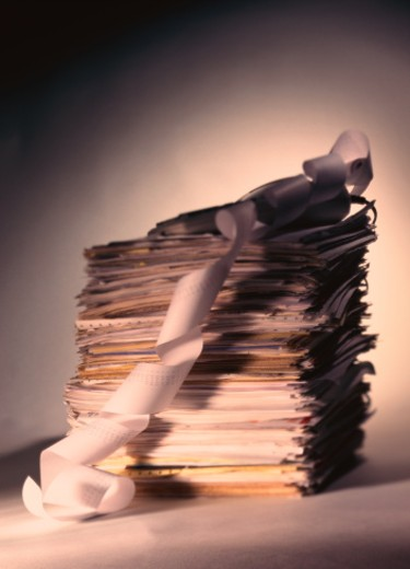 Stock Photo: 1491R-1113711 side profile of a stack of papers with a tally machine on it