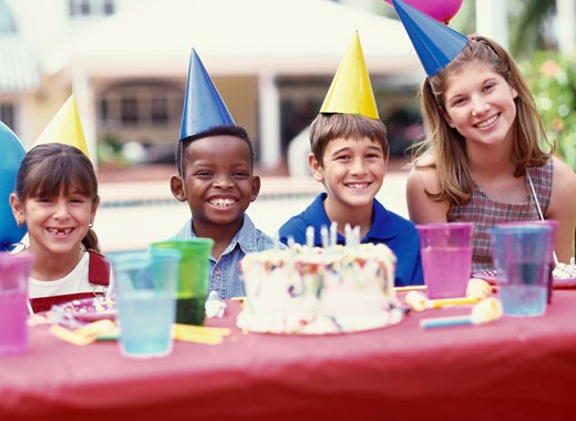 portrait of children smiling at a birthday party : Stock Photo
