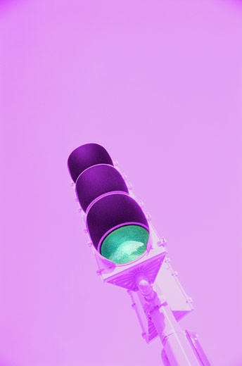toned low angle view of a traffic light turned green : Stock Photo