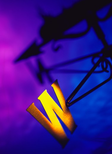 Stock Photo: 1491R-1115463 close-up of the west arm of a brass weathervane
