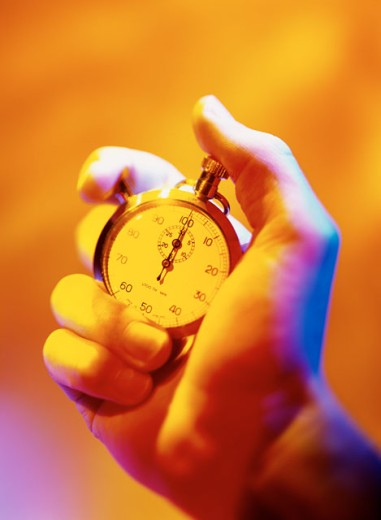 Stock Photo: 1491R-112037 toned close-up of a hand holding a stopwatch