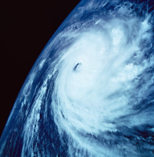 Stock Photo: 1491R-1125948 Eye of a storm over earth viewed from space