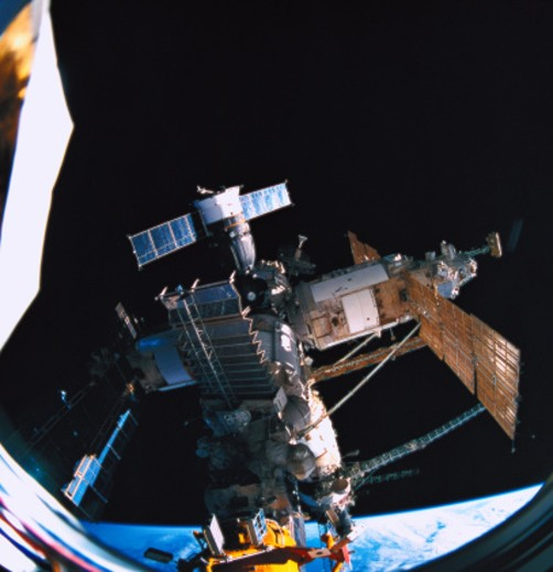 A space station orbiting above earth : Stock Photo