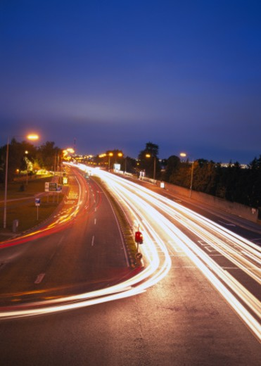 Stock Photo: 1491R-1126179 Time lapse view of traffic on a city street at night
