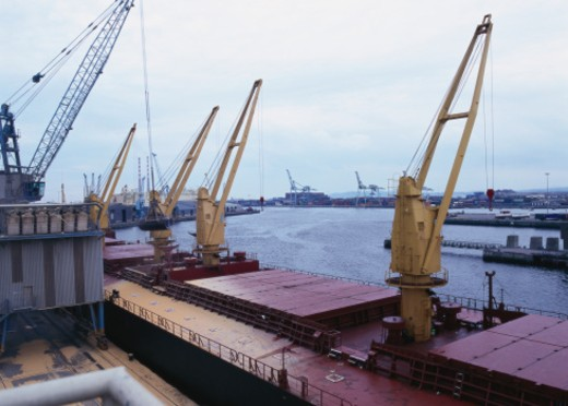 Elevated view of cranes installed on a cargo port : Stock Photo