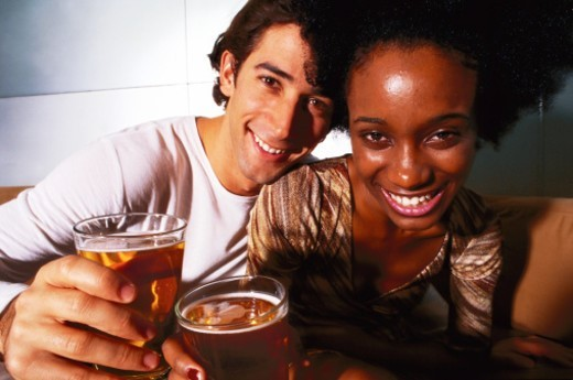 Stock Photo: 1491R-1126709 close-up of a young couple with glasses of beer in their hands