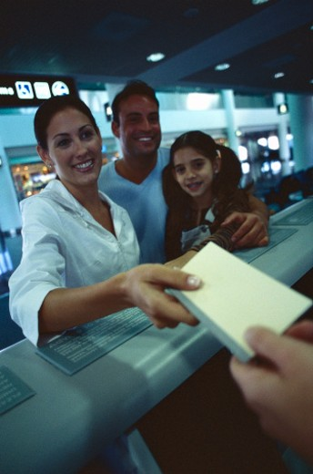view of a family at the counter handing over documents : Stock Photo